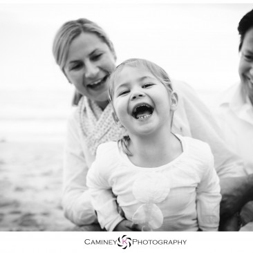 Laughing at her parents