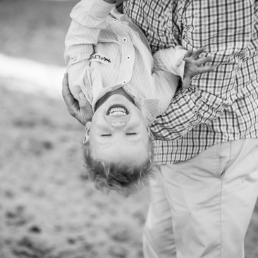 Dad suddenly hangs his son upside down during our shoot. Perfect!
